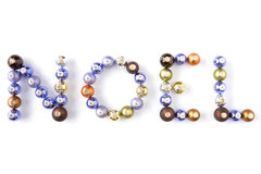 Christmas Baubles Spelling Out Noel Royalty Free Stock Photography