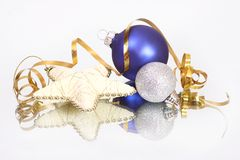 Christmas baubles and star. Christmas star and a christmas blue and silver baubles Royalty Free Stock Photos