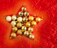 Christmas baubles in star shape on red Stock Image