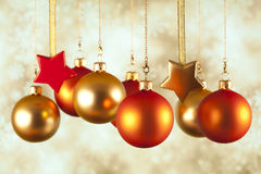 Christmas baubles and stars on abstract background Stock Photos