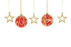 Christmas baubles and stars in a line Stock Photo