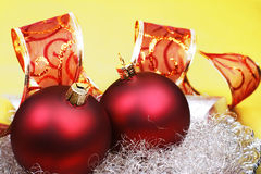 Christmas baubles, still life. Red christmas baubles with ribbon Royalty Free Stock Photography