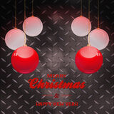Christmas baubles and text over black metal plate Stock Photo
