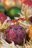Christmas baubles & tinsel. Shallow dof Royalty Free Stock Photo