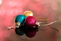 Christmas baubles on top of a table. Casting a reflection Royalty Free Stock Photos