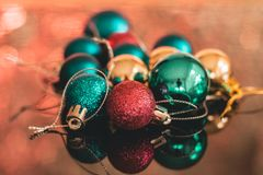 Christmas baubles on top of a table. Casting a reflection Stock Image