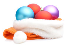 Christmas Baubles in Traditional Santa Hat Stock Photo