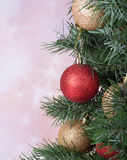 Christmas Baubles on a Tree Stock Images