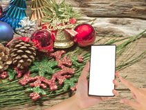 Christmas baubles and vary of decoration on wood background Stock Photography