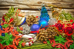 Christmas baubles and vary of decoration on wood background Stock Images