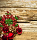 Christmas baubles and vary of decoration on wood background Royalty Free Stock Photography