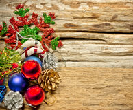 Christmas baubles and vary of decoration on wood background Royalty Free Stock Image