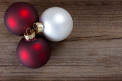 Christmas baubles on weathered wood Royalty Free Stock Images