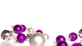Christmas baubles on white background stock video