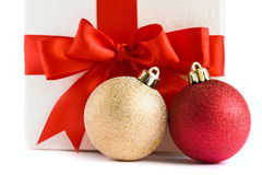 Christmas baubles and white gift box Royalty Free Stock Photos