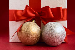 Christmas baubles and white gift box Royalty Free Stock Image