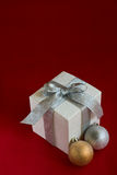 Christmas baubles and white gift box Stock Photo