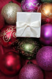 Christmas Baubles and White Gifts Stock Images