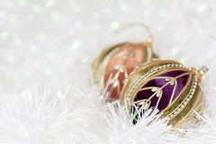 Christmas Baubles. In white tinsel, with blurred background Royalty Free Stock Photo