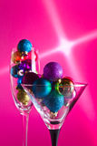 Christmas baubles. In wineglasses on a purple background Stock Photo