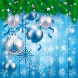 Christmas baubles on wooden background, in blue Royalty Free Stock Photos