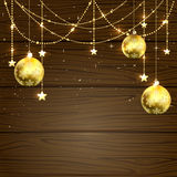 Christmas baubles on wooden background Royalty Free Stock Images