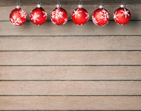 Christmas baubles on wooden background Stock Photo