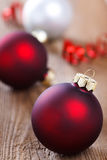 Christmas baubles on wooden board Royalty Free Stock Photography