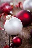 Christmas baubles on wooden board Royalty Free Stock Photo