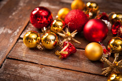 Christmas baubles on a wooden table Royalty Free Stock Image