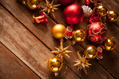 Christmas baubles on a wooden table Royalty Free Stock Photo