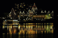 Christmas BC Legislature. Christmas lights on the British Columbia Parliament Buildings in Victoria, Canada  taken from across the harbor at a hotel on the other Stock Photo