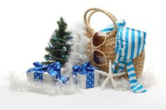 Christmas at the beach. Santa Claus hat and Christmas tree with beach accessories on white background Stock Photos