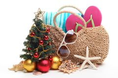 Christmas at the beach. Beach accessories and Christmas tree on white background Royalty Free Stock Photos