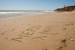 Christmas at the Beach. Sand writting of Merry Xmas Southern California Coastline - Malibu Royalty Free Stock Photography