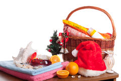 Christmas and beach accessories with basket over white Stock Photos