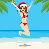Christmas Beach Jumping Girl Royalty Free Stock Images