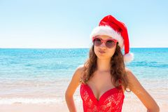 Christmas beach vacation travel portrait woman wearing Santa hat enjoying christmas on tropical beach stock image