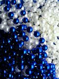 Christmas beads. Blue and white Royalty Free Stock Photos