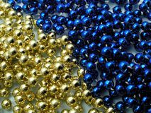 Christmas beads. Blue and gold Stock Photography