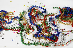 Christmas beads and Confetti Stock Image