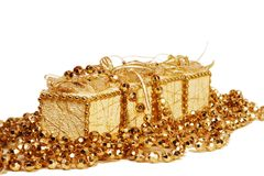 Christmas  beads and gift boxes Royalty Free Stock Photography