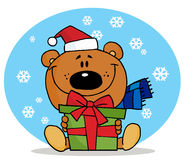 Christmas bear. Holding a present in the snow royalty free illustration