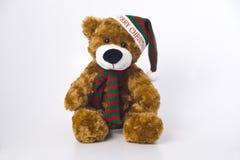 Christmas Bear. Soft Plush Bear wearing scalf and hat Stock Photo