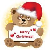 Christmas bear with banner Stock Photos