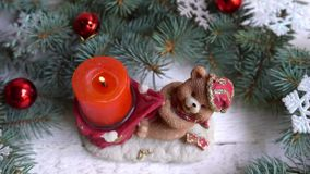 Christmas bear candle and decoration with toys. winter holiday.  stock footage
