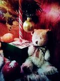 Christmas bear and caramel cane stock photography