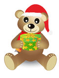 Christmas bear holding gift box. Christmas bear holding a gift box on white background Royalty Free Stock Photo