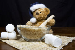Christmas Bear Making Puffed Rice Cereal Treats royalty free stock photography