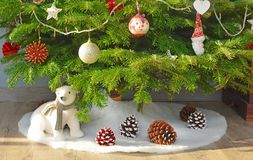 Christmas. Bear and pine cone under the  tree stock image